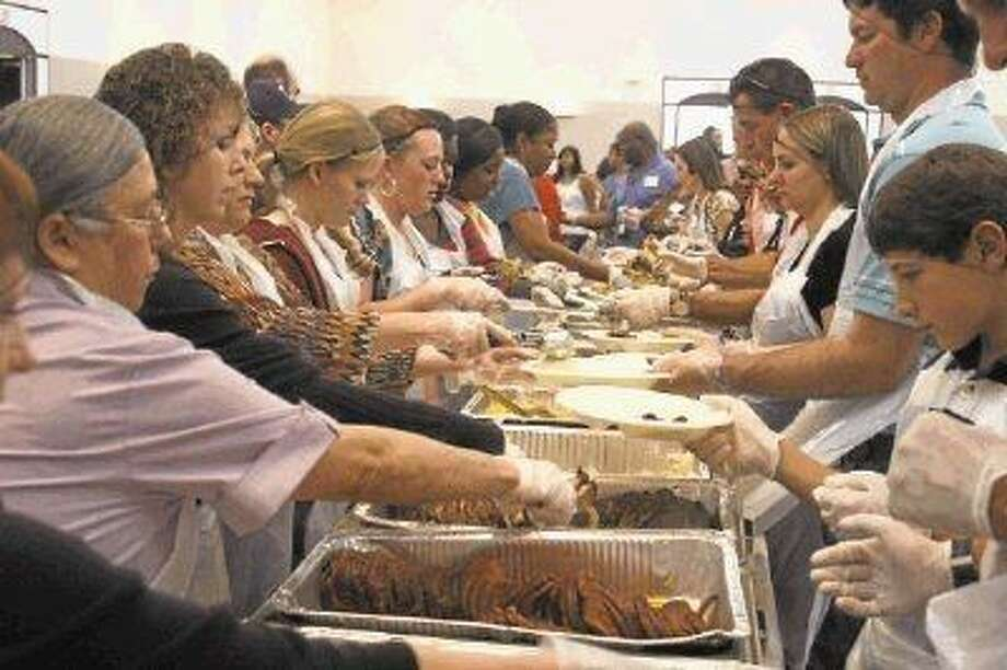 Volunteers helps with last year's Humble Thanksgiving Feast.