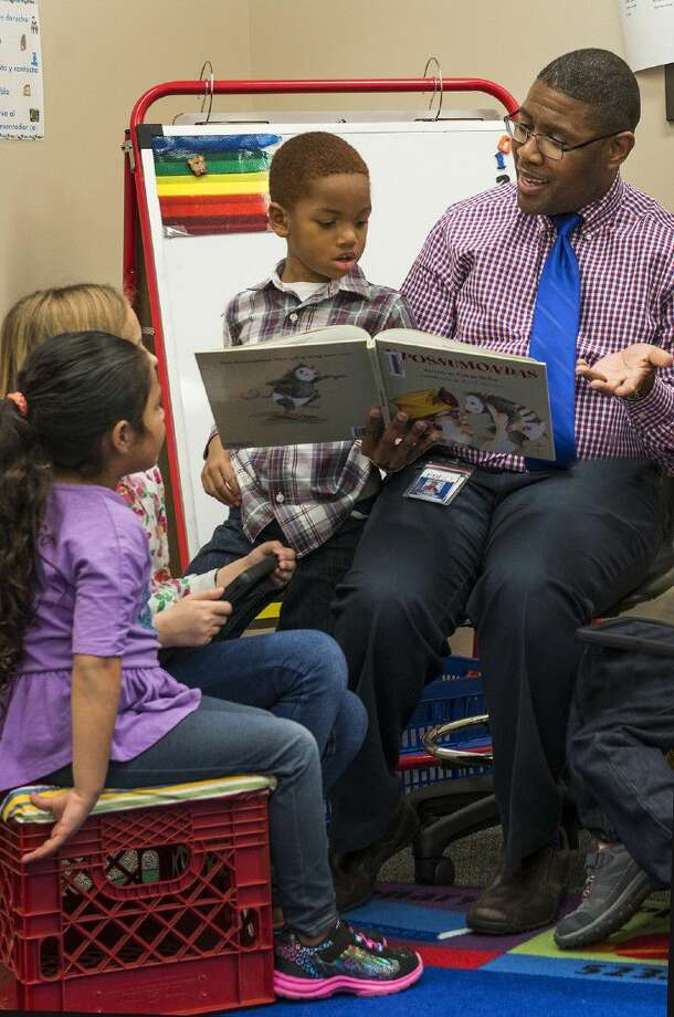 Heritage Rose Principal and FBISD Elementary School Principal of the Year Lavanta Williams reads to students Emily Alvarado, Bailey Frazier and Jaden Cowans. Heritage Rose Elementary was one of the Fort Bend schools serving Sienna Plantation posting an increase in the recent Children at Risk rankings.
