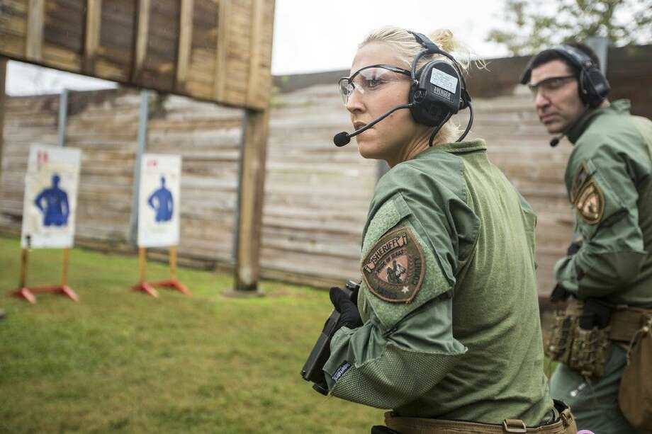 Deputy Sarah Malkowsky checks her surroundings during a handgun training exercise with the High Risk Operations Unit on Nov. 21, 2014, at the Harris County Sheriff's Office Academy and Gun Range in Humble. Photo: ANDREW BUCKLEY