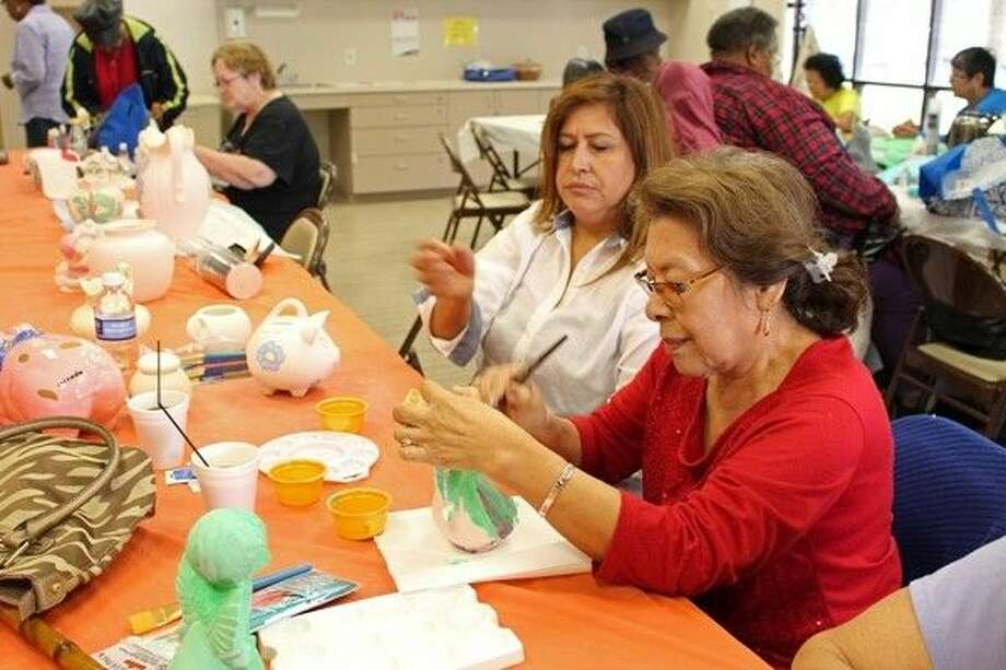 Esperanza Juarez and Leticia Gonzalez enjoy ceramics class together. Photo: Submitted Photo