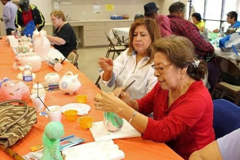 Esperanza Juarez and Leticia Gonzalez enjoy ceramics class together. Photo: Submitted Photo