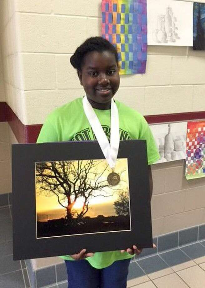 "Rogers Middle School artist Laila Dieye won gold and silver medals for her photograph ""Morning Light."""