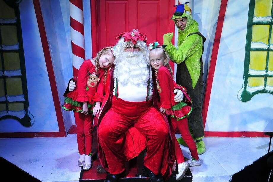 "Jordan West (from Pearland) as Santa is flanked by elves Sarah and Caitlynn Ivins (guest artists from Pasadena), while Dominique Hernandez (from Baytown) as the Young Grinch looks on in a scene from San Jacinto College's production of ""Santa's Christmas Magic, the Musical."" Photo credit: Rob Vanya, San Jacinto College marketing, public relations, and government affairs department."