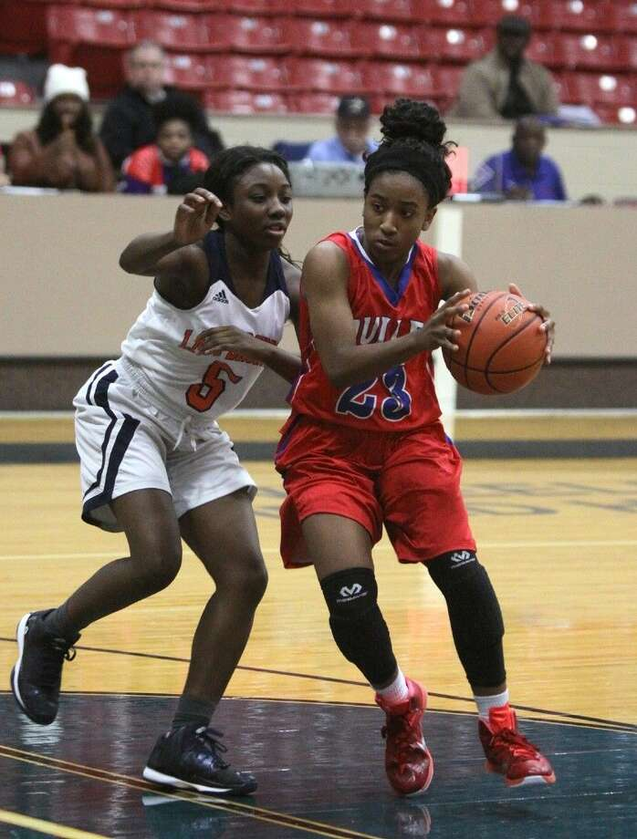 Dulles Taylre' Holcombe drives against Bush's Taejah Pittman during the Fort Bend Varsity Girls Basketball Tournament, Nov. 20 at Wheeler Fieldhouse in Sugar Land. Photo: Alan Warren