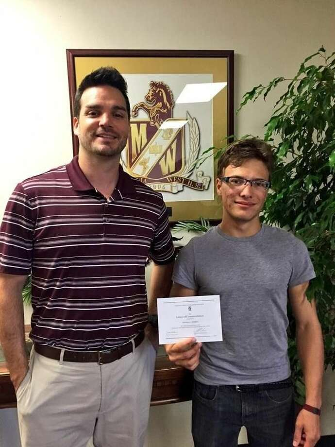Magnolia West High School senior Thomas Herben with Principal Dr. Brandon Garza. Photo: Submitted