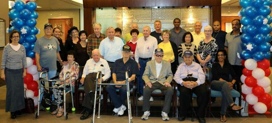 Veterans from the Korean War, Vietnam, Persian Gulf War and the War in Afghanistan gathered to share stories and friendship in the lobby at Houston Methodist St. John Hospital.