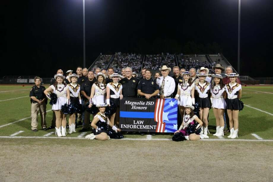 State Representative Cecil Bell Jr., County Judge Craig Doyal, Commissioner Charlie Riley, School Board President Steve Crews and Superintendent Dr. Todd Stephens honoring all the women and men in various agencies of law enforcement at the Magnolia Bowl football game. Photo: MISD