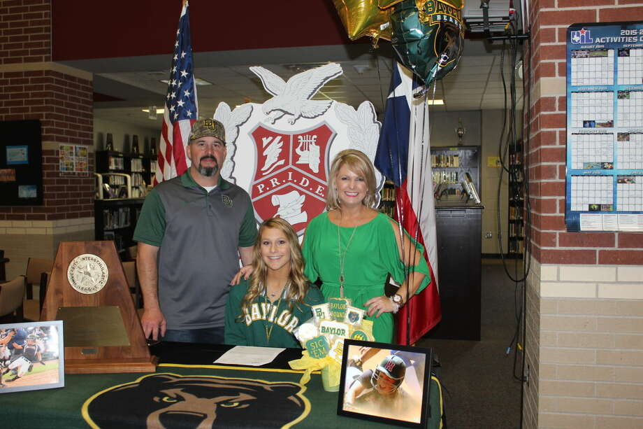 Madi O'Neal is signing to go play college softball at Baylor University. Madi is the starting left fielder on the State Champions Huffman-Hargrave softball team. Pictured with her are her parents Missy and Dustin O'Neal