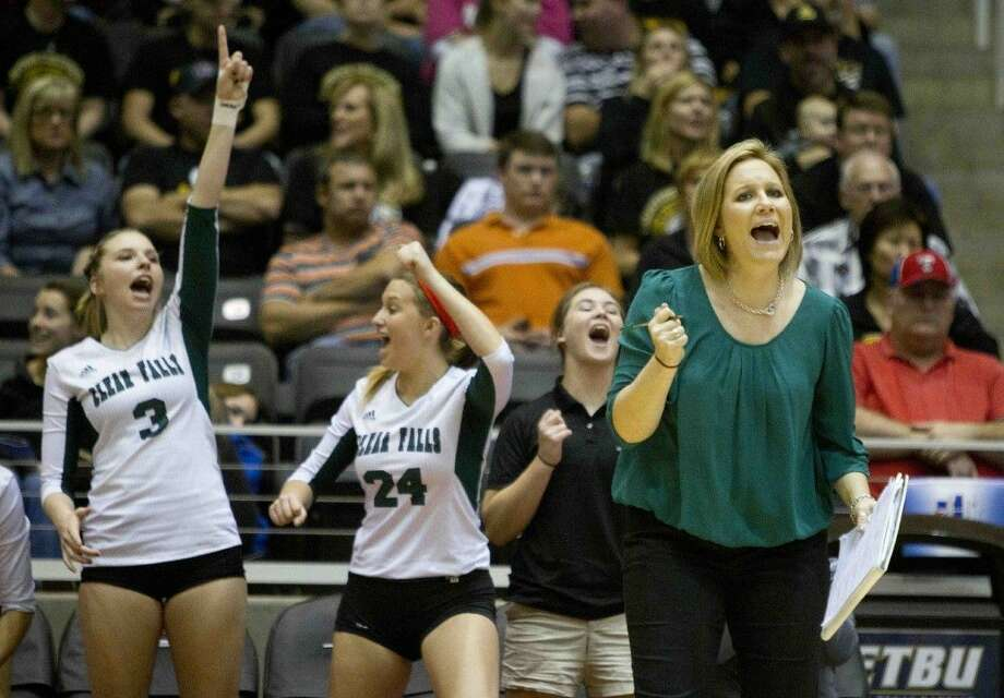 Clear Falls' head coach Lyndsay Hodges encourages her team during a Class 6A state semifinal game against Amarillo during the UIL State Volleyball Championships at the Curtis Culwell Center in Garland Friday. Photo: JASON FOCHTMAN