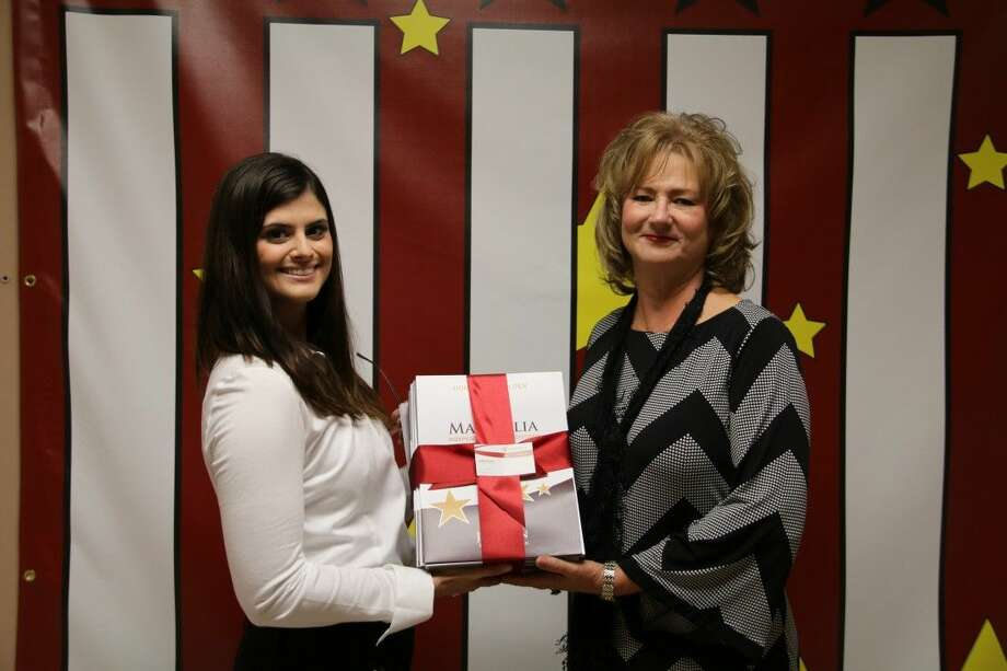 Lyon Elementary Principal Tammy Haley receives 1,000 check from Emerus Community Hospital Assistant Brand Manager Lindsay Borras for new folders. Photo: MISD