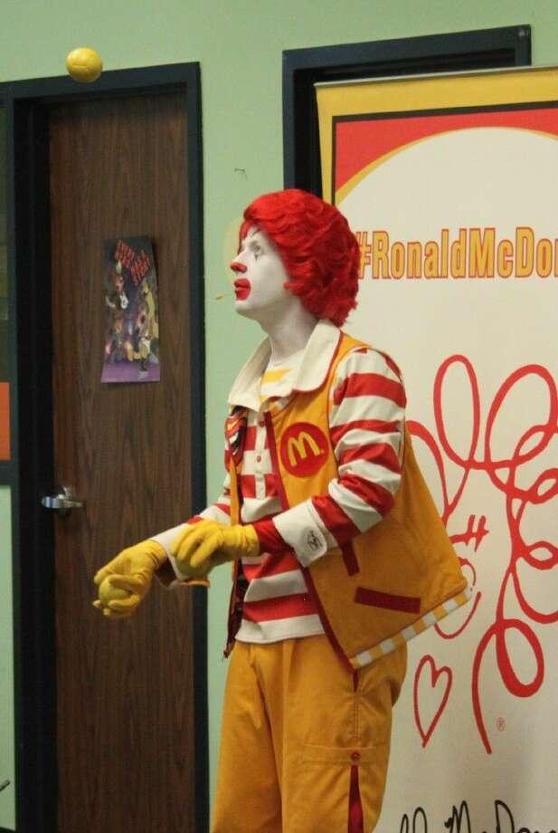 Ronald McDonald opens his act with an impressive juggling feat. Photo: Jacob McAdams