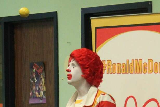 Ronald McDonald opens his act with an impressive juggling feat.