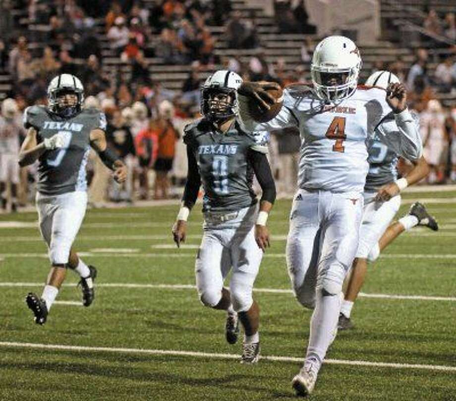 Dobie quarterback Jeremy Davis (4) runs in a touchdown uncontested Friday October 30 against Sam Rayburn. Photo: Kar B Hlava