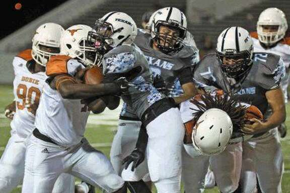 Sam Rayburn running back Stanley Hackett (1) gets stopped by Dobie Friday October 30.