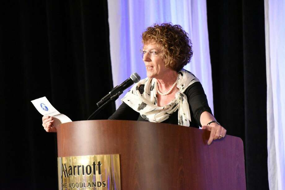 Dr. Victoria Constance, executive director and CEO of the Board of Directors for Children's Safe Harbor, speaks at the organization's annual Betting on Courage dinner fundraiser, hosted May 6 at The Woodlands Waterway Marriott Hotel and Convention Center.