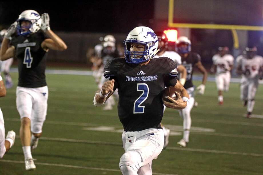 Friendswood quarterback Tyler Page (2) runs past Clear Brook's defense for a touchdown Friday night. Photo: Kar B Hlava