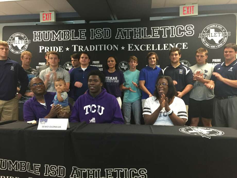 Kingwood running back Sewo Olonilua signs with TCU on Wednesday surrounded by family, friends, teammates and coaches.