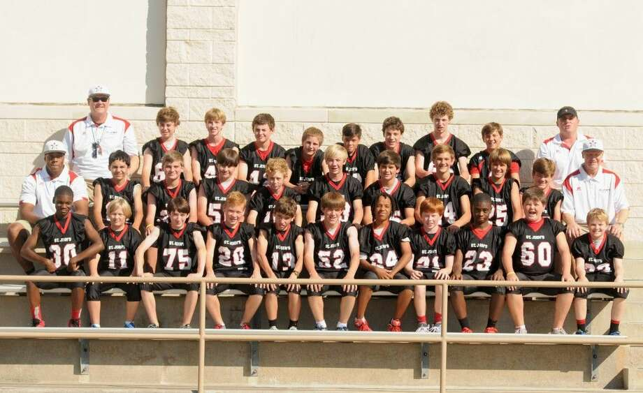 The St. John's seventh grade team posted a perfect 9-0 mark this season and it was the middle school's first unbeaten football team since 1974. In the back, from the left, Head Coach Bond Millard, Andrew Smith, Will Skinner, Beckett Vine, Lucas Desjardins, Dre Arreola, Will Leger, Miller Humphreys, Peter Cannon, and assistant Coach Jeb Ligums. Middle row: Assistant Coach Andrew Stewart, Michael Musallam, William Urdahl, Will Heilmann, Sam Finney, Jackson Masterson, Ben Morris, Will Sampson, Drew Woodcox, Jack Curtin, and Assistant Coach Sam Chambers. In front, Aloye Oshotse, Sam Askew, Scotty Malcolm, Jackson Heijmen, Thomas Grannen, Davis Rae, Chad Faykus, Cameron Howley, Cameron Mudd, Stuart Wallace, and Will McKone. Not pictured is Daniel Schann.