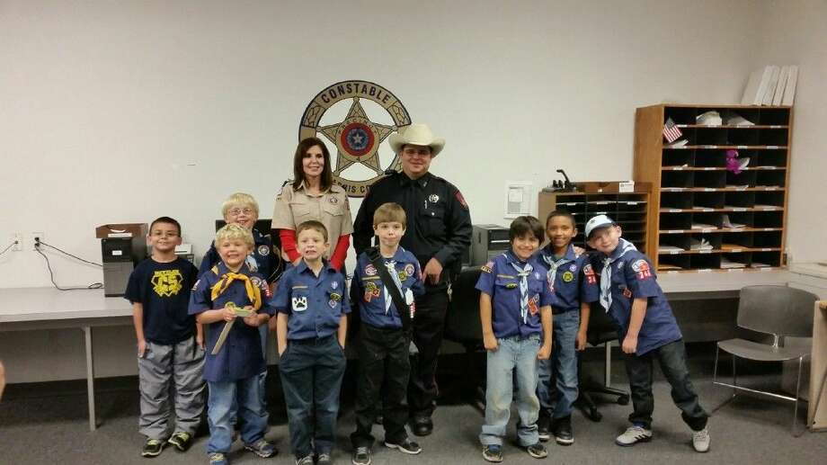Cub Scout Troop No. 346, Den 8 and 9, made a visit recently to the North Hampton subdivision substation of Harris County Constable Ron Hickman's office. Photo: Submitted Photo