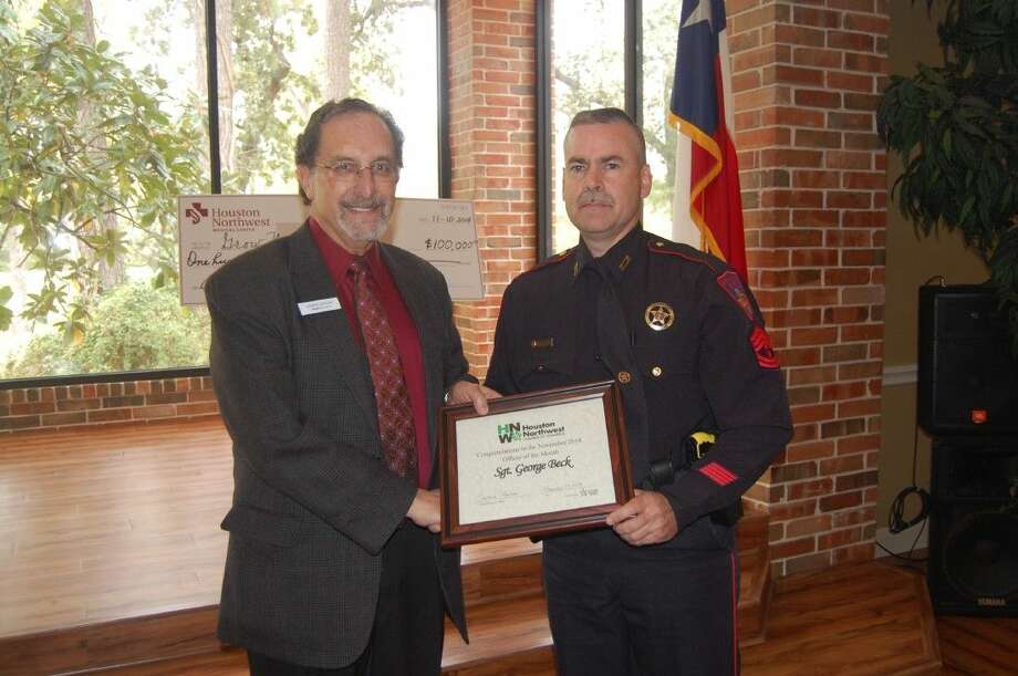 Larry Lipton with the Houston Northwest Chamber of Commerce presents Sgt. George Beck with the Deputy of the Month certificate from the chamber at the November luncheon at Shirley Acres. Photo: Submitted Photo