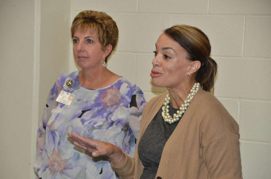 Debra Hill, director of secondary science, and Karen Rawls, Chevron public affairs representative, speak to educators at the JASON Learning Mini Conference on Nov. 4 at the Berry Center. More than 300 educators attended the four-day STEM learning sessions. Photo: Submitted Photo