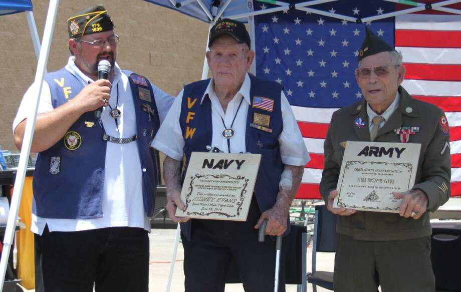 VFW Post 1839 Commander Brad Newby (left) presents awards to World War II veterans during the Salute to the Troops event at Cleveland Walmart on June 18. The veterans are Sid Evans (middle) of the United States Navy and Eleak Thomas Clark (right) of the United States Army. Photo: Jacob McAdams