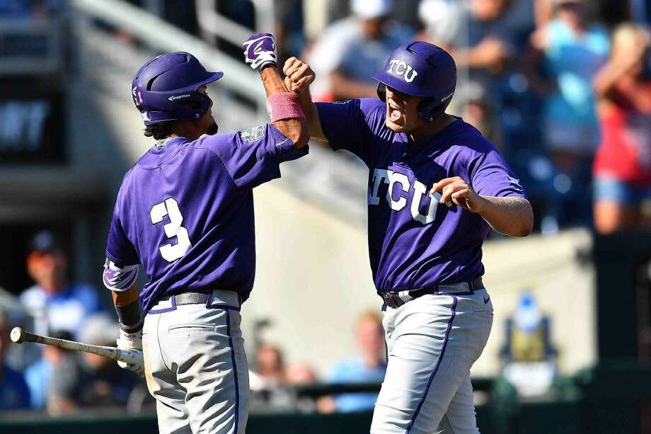 TCU short stop Elliott Barzilli (3) and designated hitter Luken Baker, an Oak Ridge grad, celebrate Baker's three-run homer in the top of the ninth inning to help TCU edge Texas Tech 5-3 in Game 3 of the 2016 College World Series at TD Ameritrade Park in Omaha, Nebraska on Sunday.