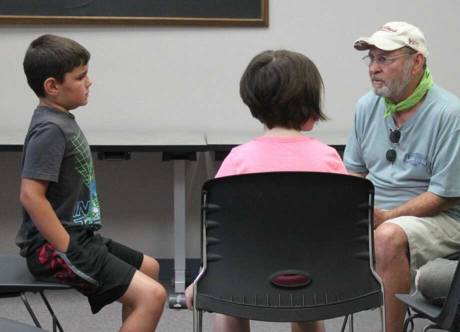 Carl Richardson (right) tells a group of children about his time as the captain of a shrimp boat during Coldspring Area Public Library's Summer Reading program on June 15. Photo: Jacob McAdams