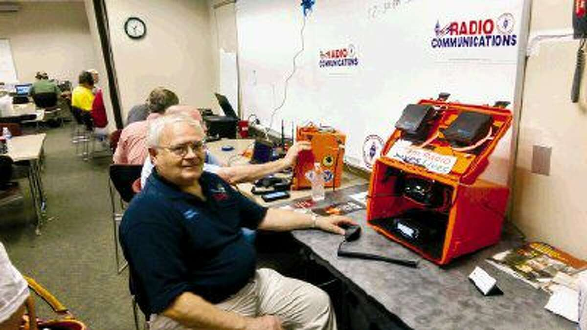 Boyd Bilger is using what is called a GO KIT. A GO KIT is setup with radios and designed to be easily deployed during an emergency and ready for connections to either a portable power supply or the mains. This is one of the radios Scouts use during Field Day.