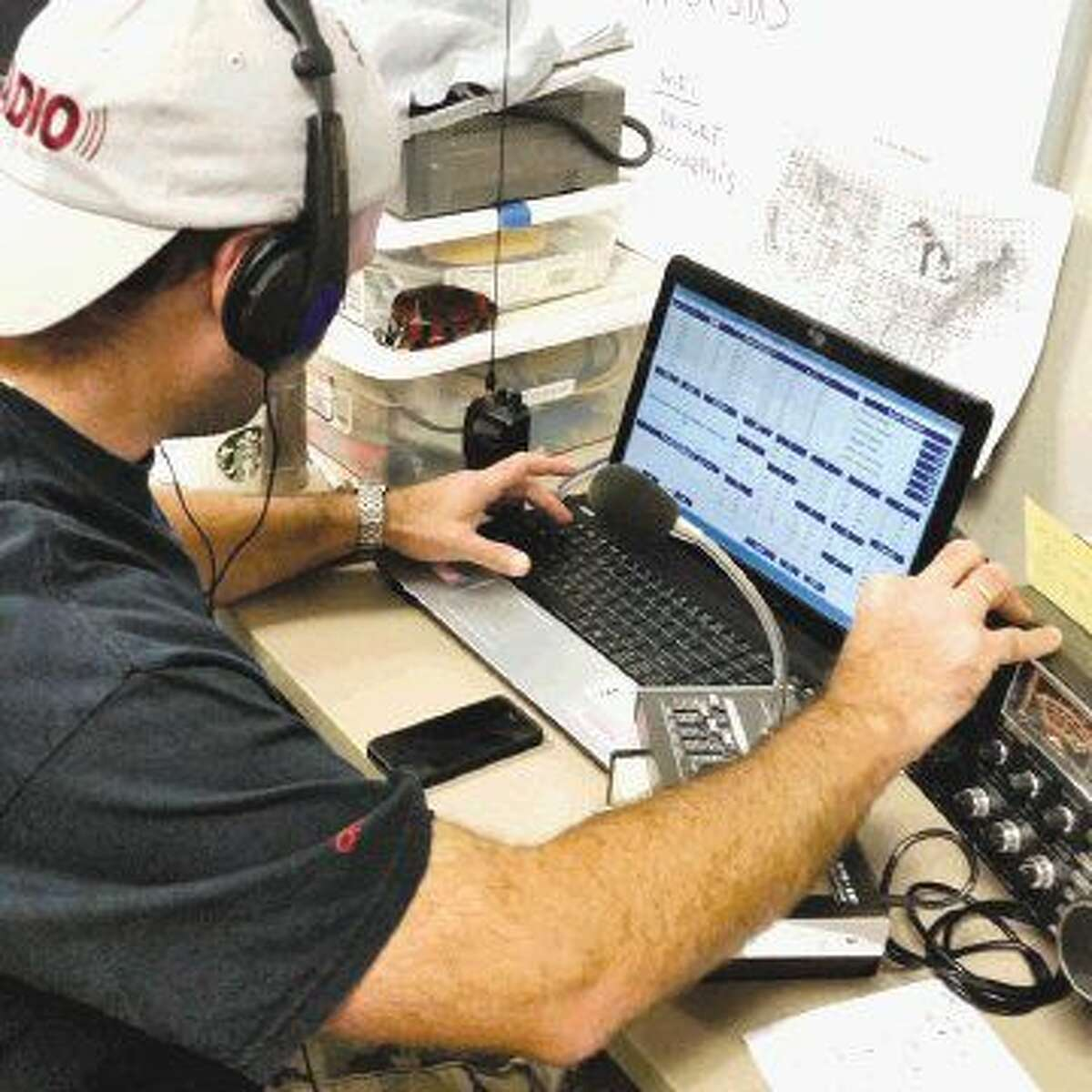 TEAC secretary Bran Sasic is logging a contact while listening to the person on the radio give his Field Day station's call sign.