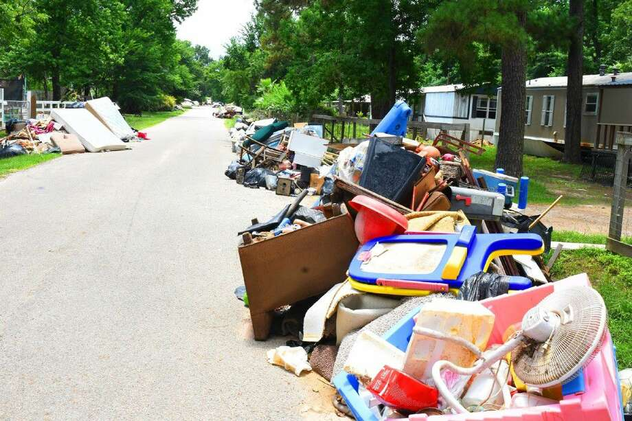 Residents along Valle Street and Foxwood off of state Highway 249 along Spring Creek continue to clean up this week following the devastating floods on Memorial Day weekend. Photo: Tony Gaines