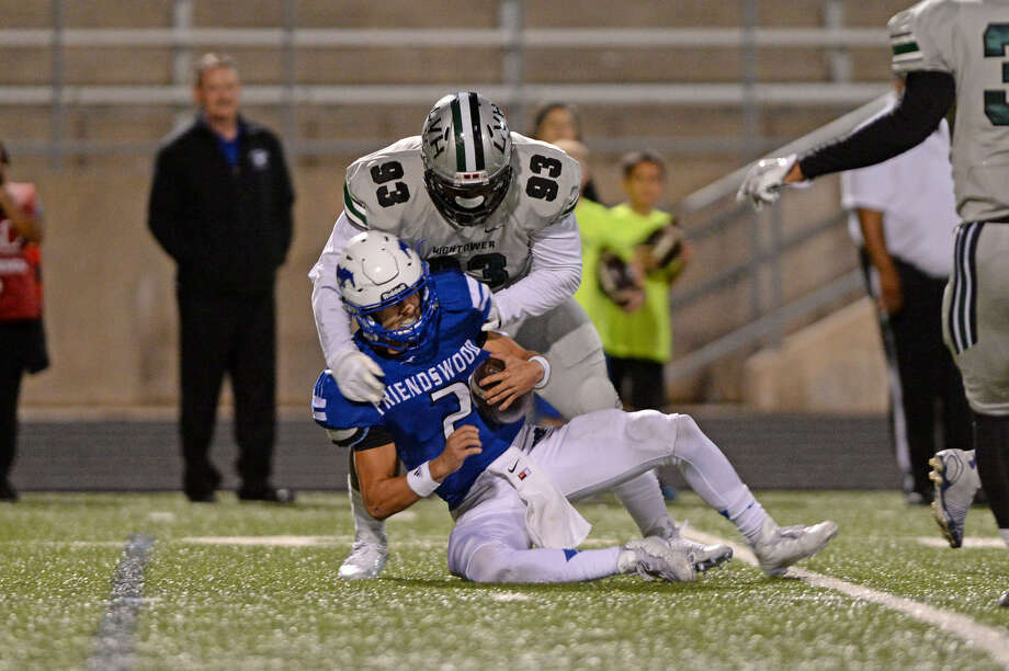 Hightower's Darien Wilson brings down Friendswood quarterback Tyler Page during their Class 6A bi-district playoffs Nov. 12 at Hall Stadium in Missouri City. The Mustangs won 27-24. To view or purchase this photo and others like it, visit HCNpics.com. Photo: Craig Moseley