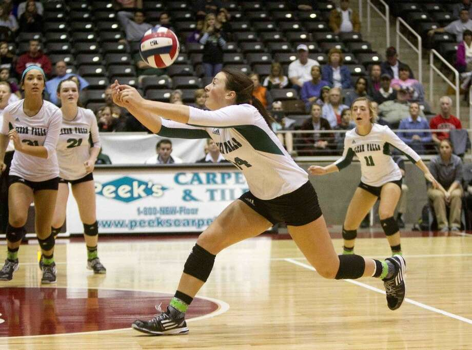 Clear Falls' Alyssa Enneking returns a hit during a Class 6A state championship game at the UIL State Volleyball Championships in Garland Saturday. The Woodlands defeated Clear Falls 3-1 to win their second straight state title. To view or purchase this photo and others like it, visit HCNpics.com.