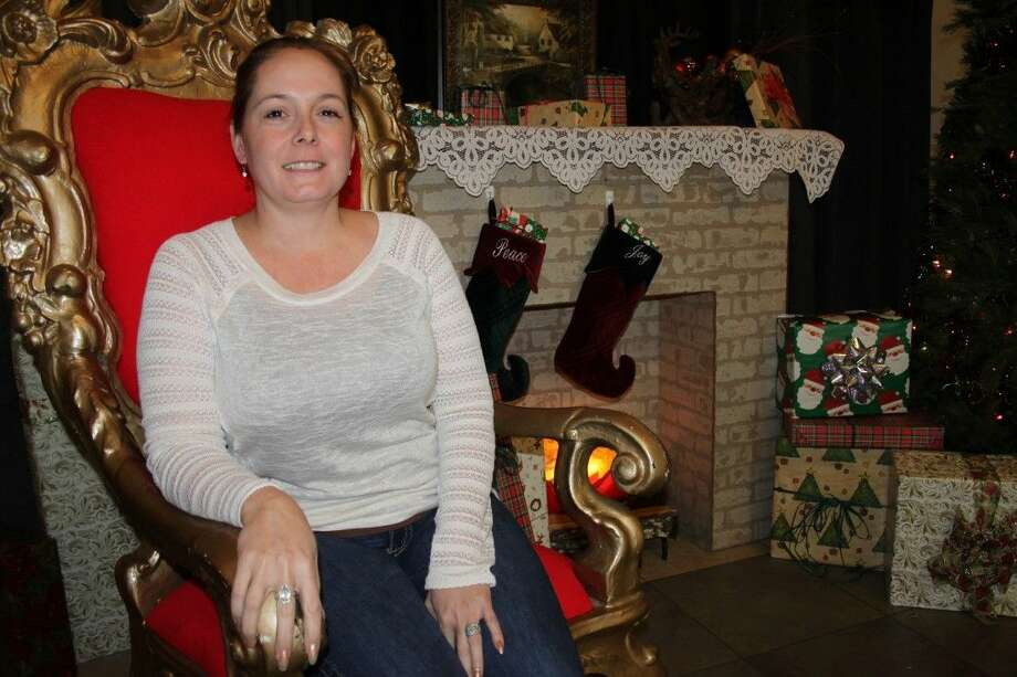 Amanda Johnson Wilson sits in Santa's chair at the Dayton Community Center, where she works as the community center director. Wilson might not be Santa, but she helps provide Christmas to hundreds of local children through Liberty County Bikes for Christmas. Photo: Vanesa Brashier