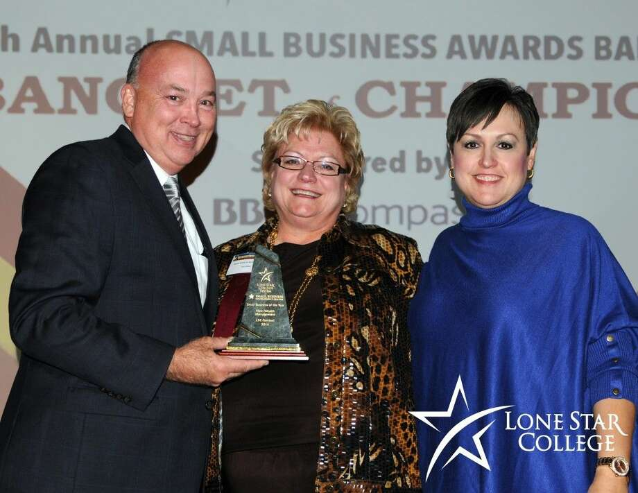 Klein Wealth Management receives the 2014 Small Business of the Year Award, Lone Star College-Tomball, at the 28th annual Small Business Awards Banquet. Shown here (left - right) are Stephen Head, chancellor Lone Star College; Lori Klein of Klein Wealth Management; and Dr. Lee Ann Nutt, acting president Lone Star College-Tomball, who made the presentation. Photo: Submitted