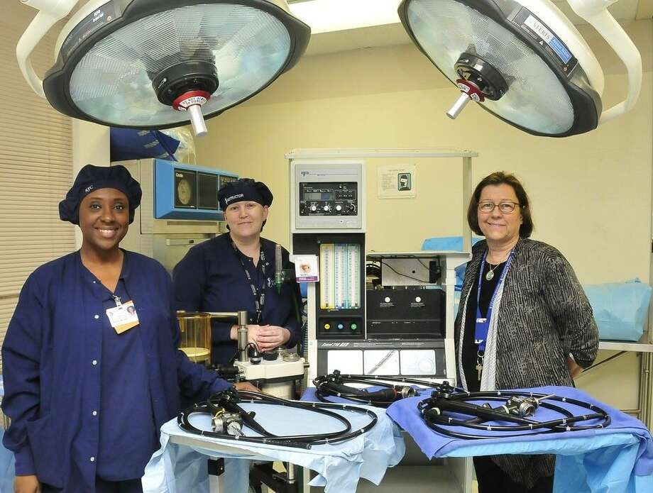 San Jacinto College student Dorothy Mitchell; Katie Goolsby, San Jacinto College surgical technology instructor; and Catherine Yendell, San Jacinto College surgical technology program director, stand alongside medical equipment recently donated by Bayshore Medical Center to San Jacinto College. Photo credit: Jeannie Peng-Armao, San Jacinto College marketing, public relations, and government affairs department.