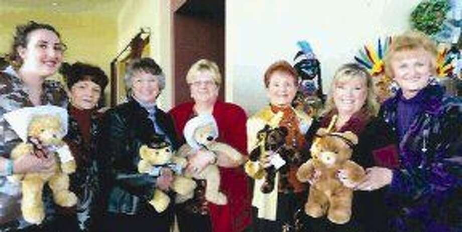 """Displaying some of the Pilgrim and Indian-dressed treasured bears are active """"Heartbeat Bears"""" members. Pictured from left to right are Olivia Smith, Helen McInnis, Lee Ann Sprick, Debbie Campbell (president of Hi Neighbor), P.V. Fitzharris, Nancy Foisner and Kay Caffey."""