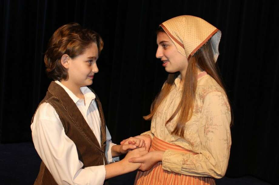 "Daniel Malev plays ""Perchik"" and Ella Bernstein plays ""Hodel"" in the JCCS production of Fiddler on the Roof Jr. Dec. 4-11, 2014. Photo: Submitted"