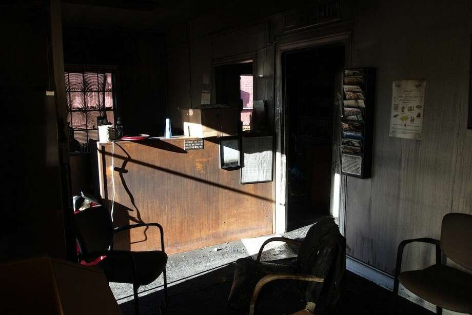 Shown here is the front office of Dayton's Berkeley Eye Center following the fire that burned the rear part of the office Sunday, Nov. 23. Photo: Casey Stinnett