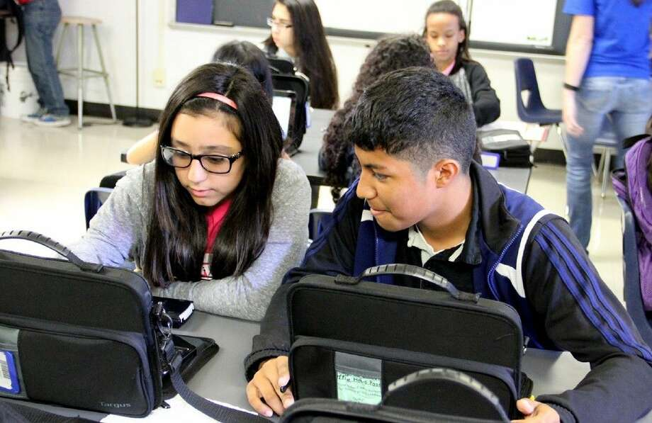 Thompson Intermediate students, Meghan Godeke and David Gomez, work together in the Connect program.