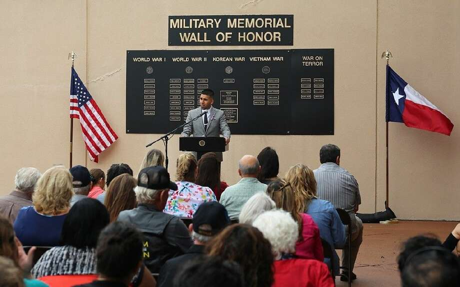 ACC alumnus and Iraq combat veteran Timothy Rojas speaks during the Veterans Day Ceremony on November 11 in front of the Memorial Wall.