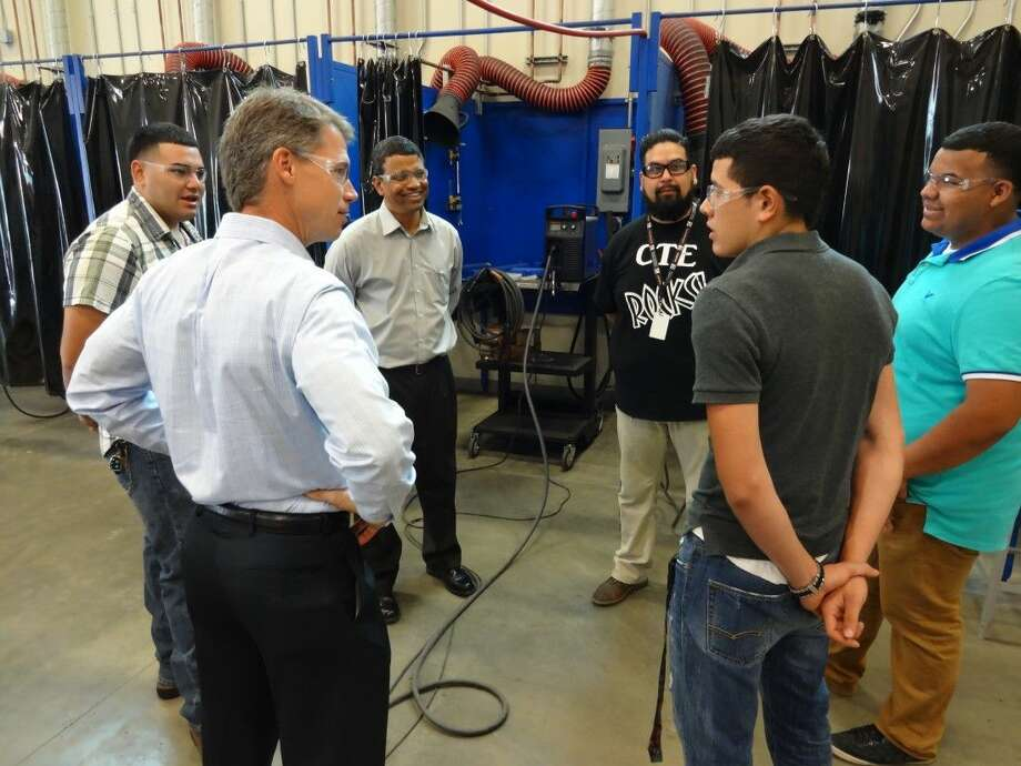 Discussing career opportunities are (left to right): Daniel Zamora, PISD Student, Greg Nevermann, LyondellBasell refining, product and planning director, Walter Pinto, Bayport site manager, Ezequiel Garcia, PISD welding instructor, Alejandro Gutierrez, PISD student and Raul Martinez, also a PISD student.