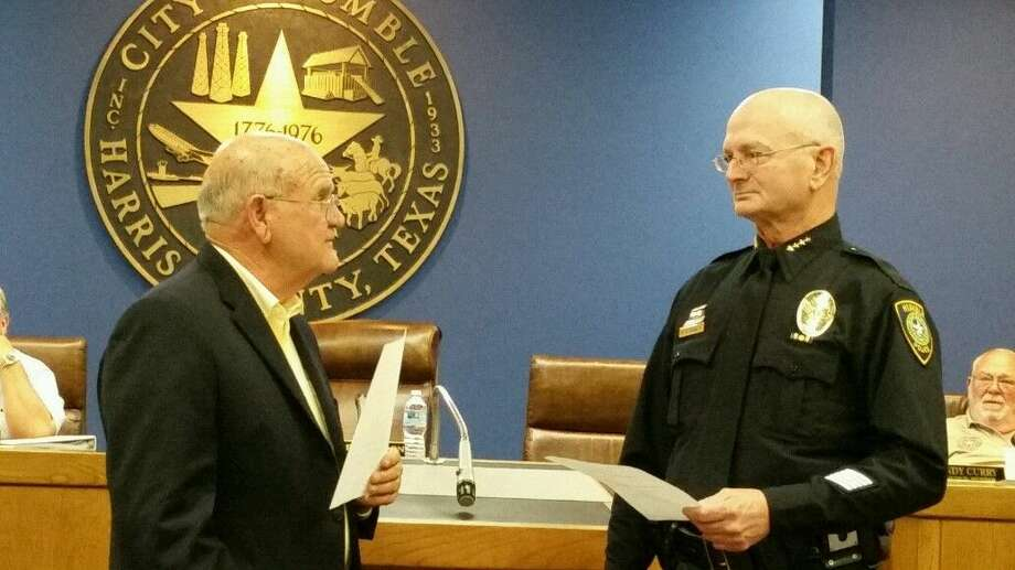 Humble Mayor Merle Aaron officially swears in new Police Chief Delbert Dawes at Humble City Hall Thursday, Nov. 12, 2015.