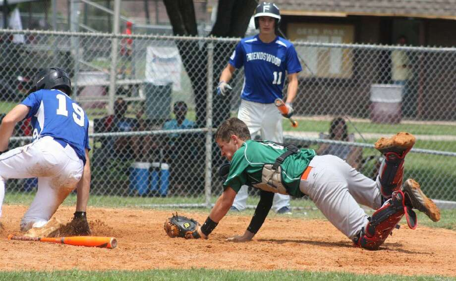 The first of Friendswood's 16 runs eludes NASA-Green's catcher during the team's big first inning. Photo: Robert Avery