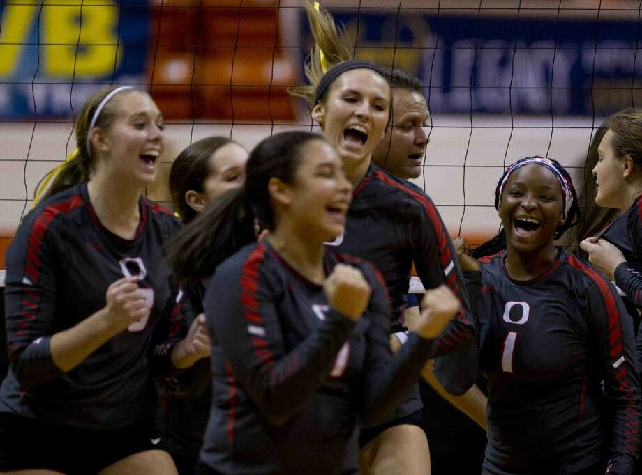 Oak Ridge celebrates after defeating Dallas Highland Park 3-1 during a Region II-6A regional semifinal match Friday in Huntsville.