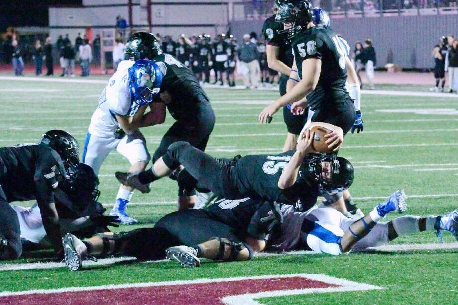 Pearland's Chase Foster (15) rolls into the end zone against West Brook Friday night in Pearland. Photo: KIRK SIDES