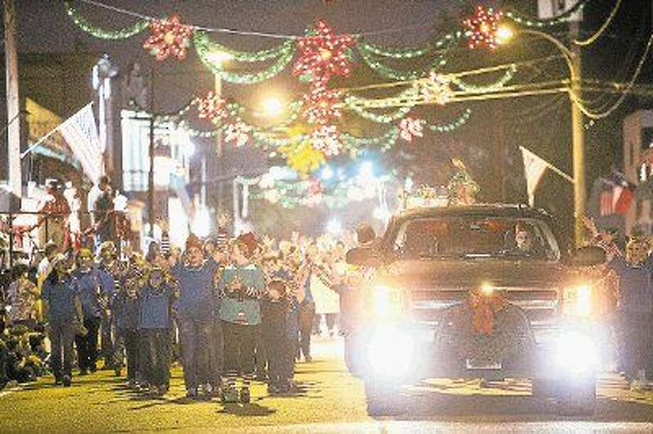 The Humble area's First Baptist Church Praise Kids sing as they walk down Main Street during the 22rd Annual Christmas Parade of Lights two years ago. Photo: ANDREW BUCKLEY