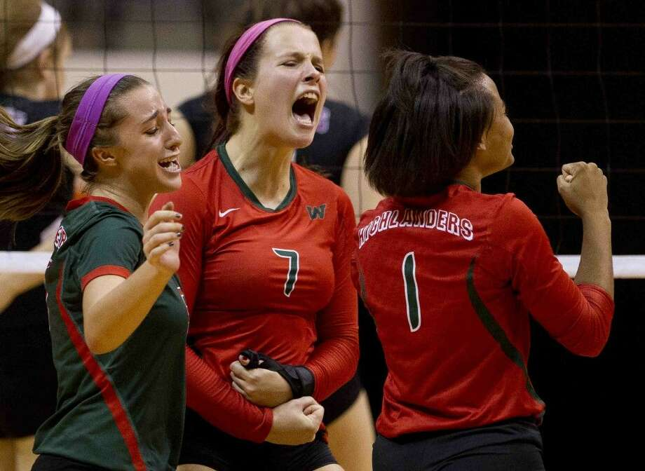 The Woodlands' Hannah Hickman, center, Mia Primavera, left, and Skylar Scott celebrate after defeating JJ Pearce, 3-1 during a Region II-6A regional semifinal match Friday, Nov. 13, 2015, in Huntsville. To view or purchase this photo and others like it, visit HCNpics.com.