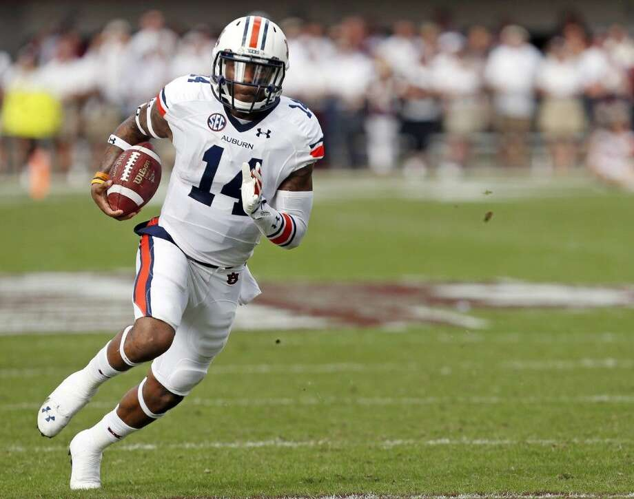 Auburn quarterback Nick Marshall will lead the Tigers against Alabama in this year's edition of the Iron Bowl.