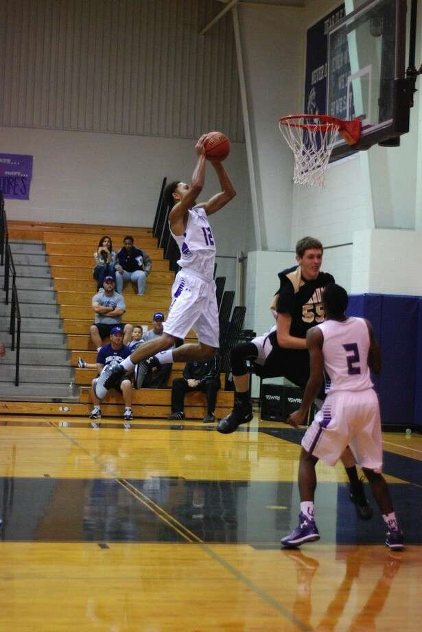 Xavier Eaglin flies up for two on a dunk during the Broncos' 75-37 win over Anahuac on Tuesday, Nov. 25, 2014. Photo: Casey Stinnett